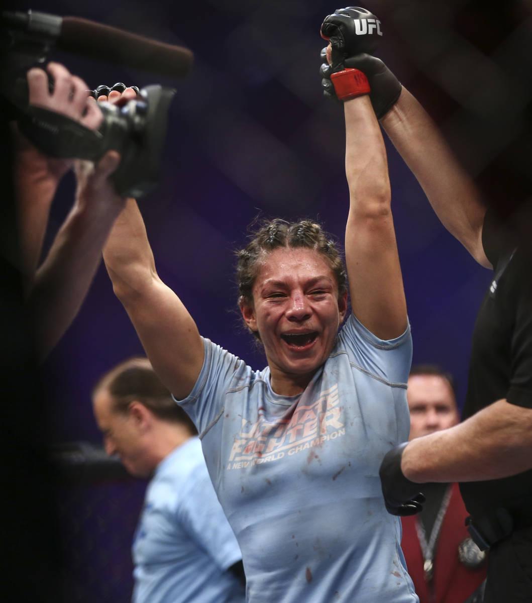 Nicco Montano celebrates after defeating Roxanne Modafferi via unanimous decision in a women's ...