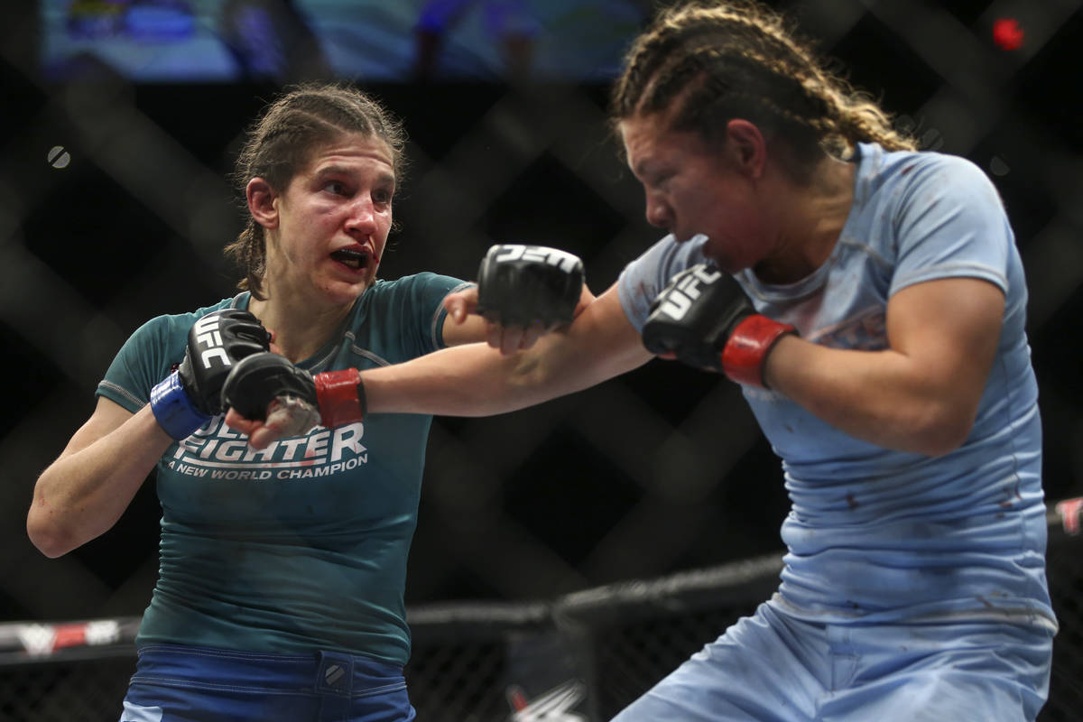 Roxanne Modafferi, left, fights Nicco Montano during a women's flyweight title bout at the Par ...