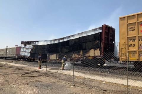 Crews battle a flatbed rail car Sunday, Aug. 8, 2021, at 926 S. Commerce St. in Las Vegas. (La ...
