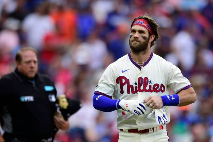 Philadelphia Phillies' Bryce Harper, right, is congratulated in the dugout by Alec Bohm after H ...