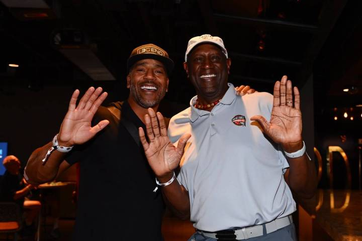 Retired NBA players Jim Jackson (left) and Spencer Haywood (right) pose for a photo during the ...