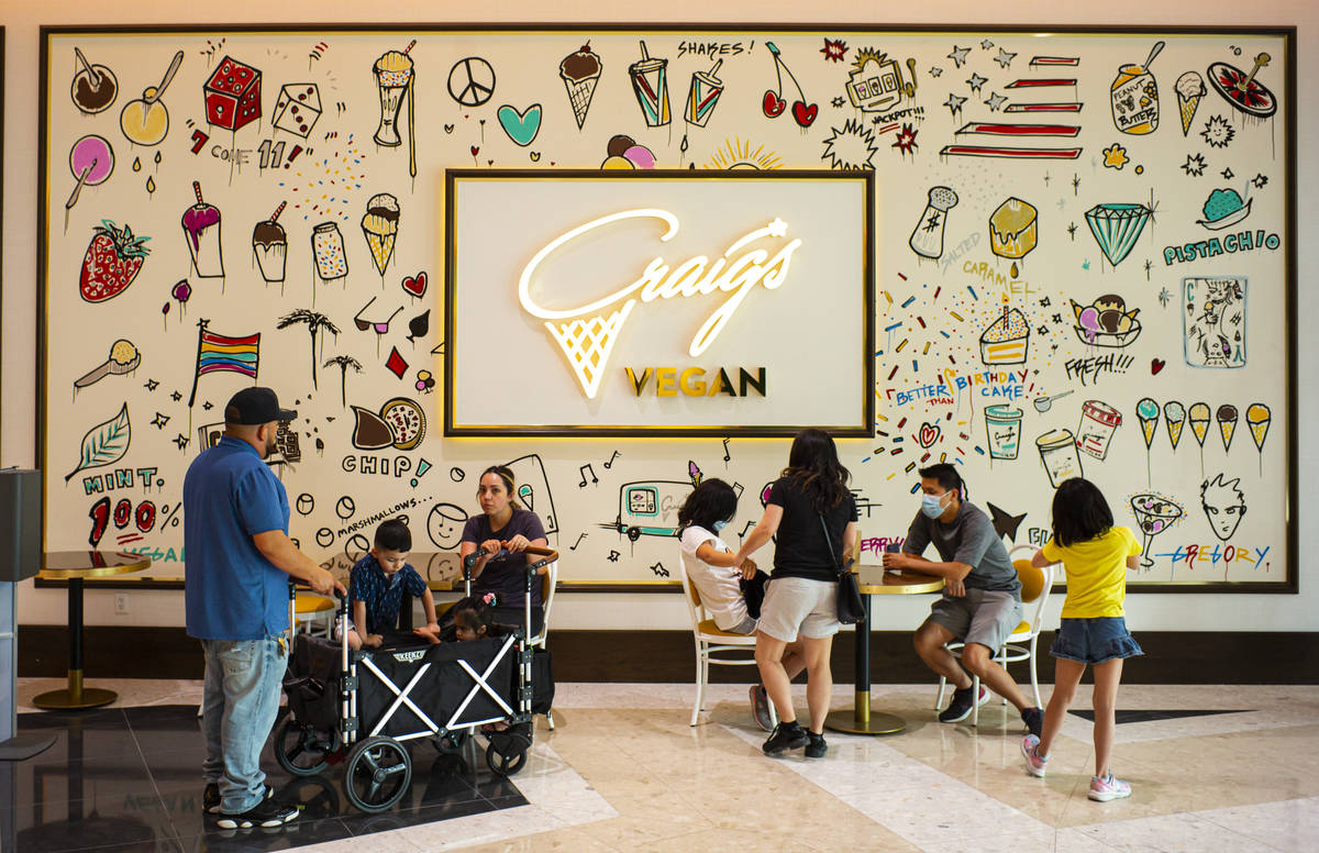 People sit outside of Craig's Vegan ice cream in The District at Resorts World Las Vegas. (Chas ...
