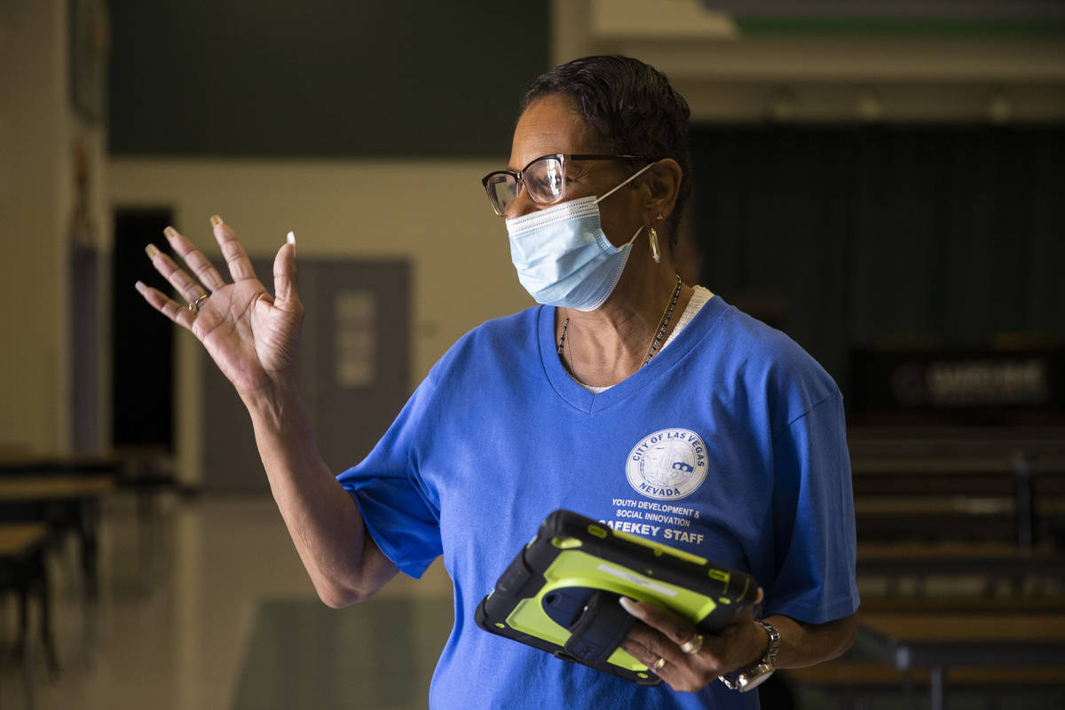 Safekey assistant site lead Troye Boudreaux waves goodbye to a child at Garehime Elementary Sch ...