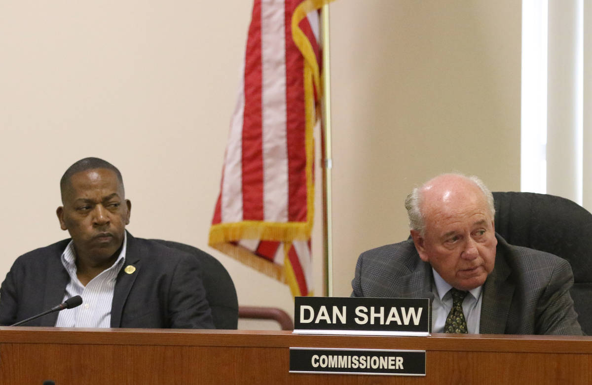 Southern Nevada Regional Housing Authority commissioners, Lawrence Weekly, left, and Dan Shaw t ...
