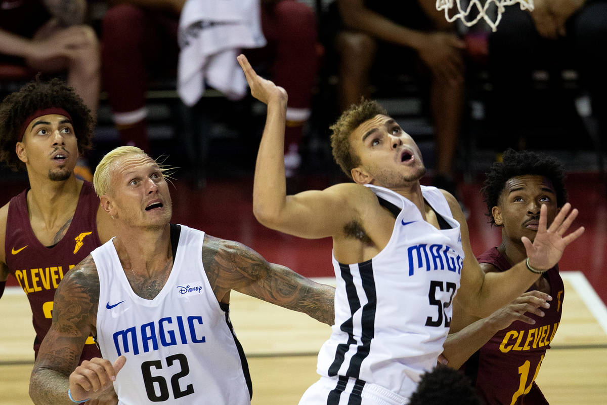 Orlando Magic forward Janis Timma (62) and forward D.J. Hogg (52) watch to see if their point w ...