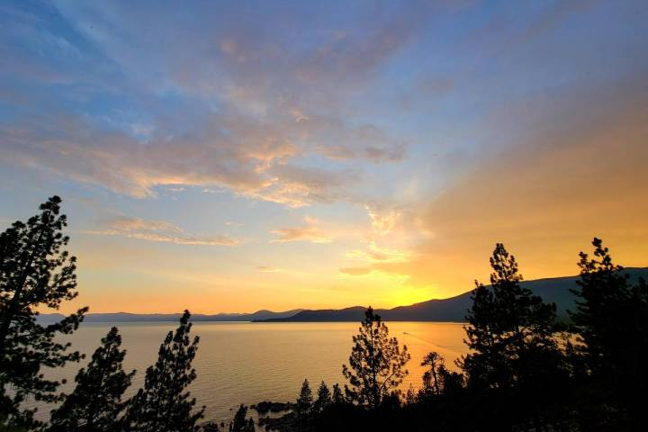 A Lake Tahoe sunset plays out above Incline Village in July as seen from the East Shore Tahoe T ...