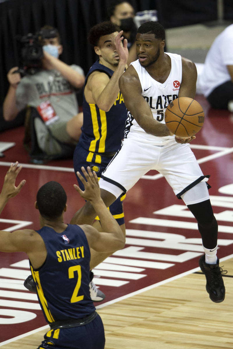 Portland Trail Blazers guard Emmanuel Mudiay (58) gains control of the ball surrounded by India ...