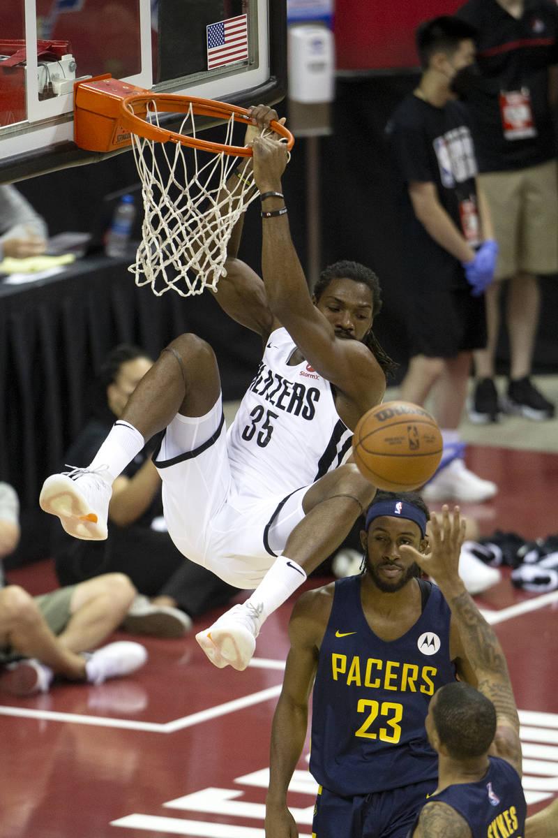 Portland Trail Blazers forward Kenneth Faried (35) dunks above Indiana Pacers forward Isaiah Ja ...