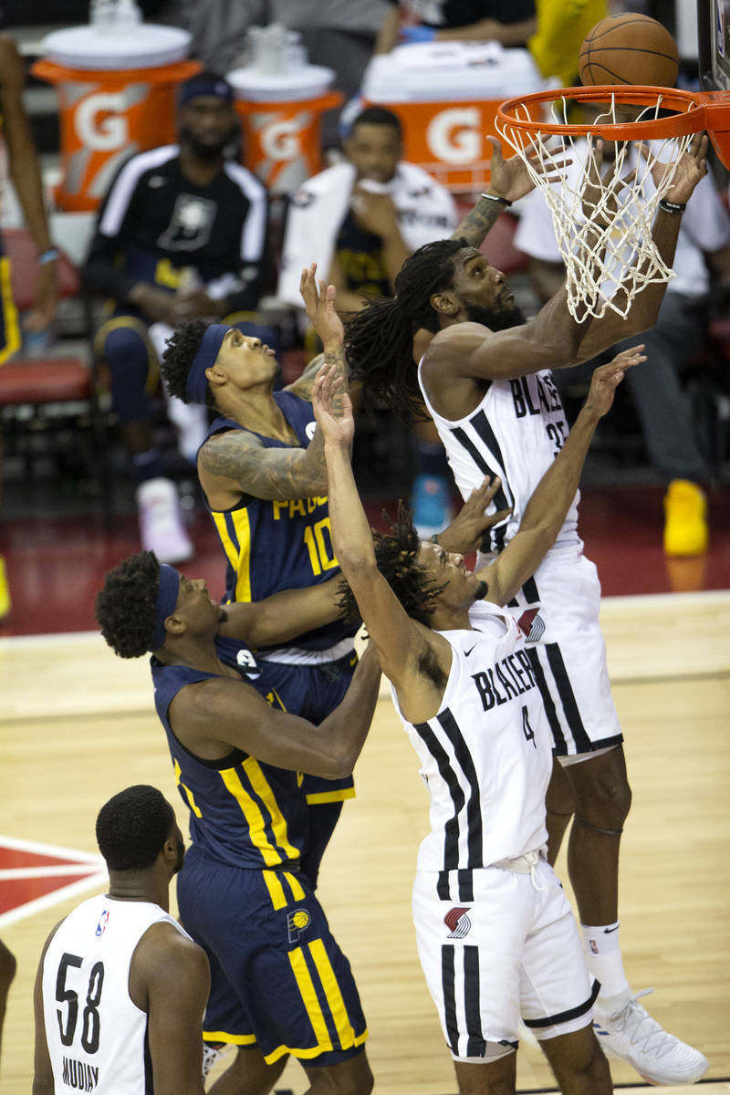 Portland Trail Blazers forward Kenneth Faried (35) jumps to intercept a layup by Indiana Pacers ...
