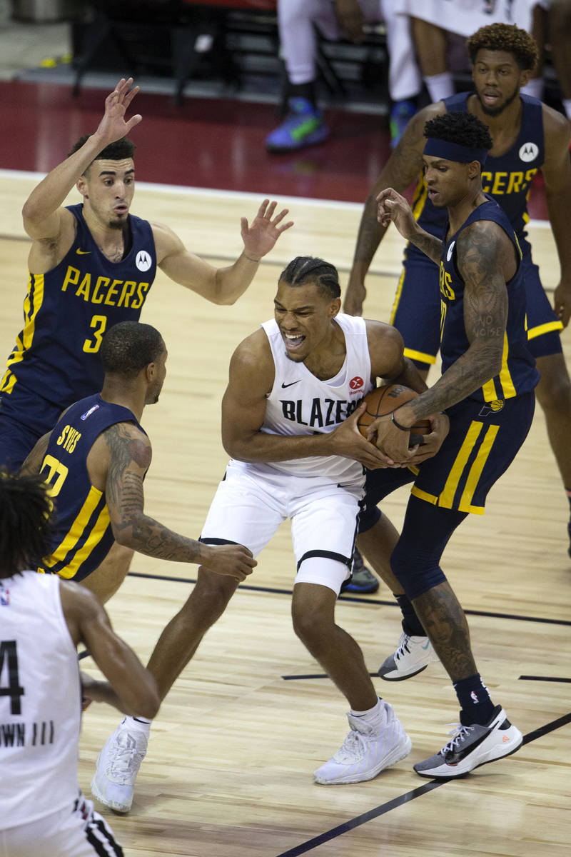 Portland Trail Blazers forward George King (8) fights for the ball surrounded by Indiana Pacers ...