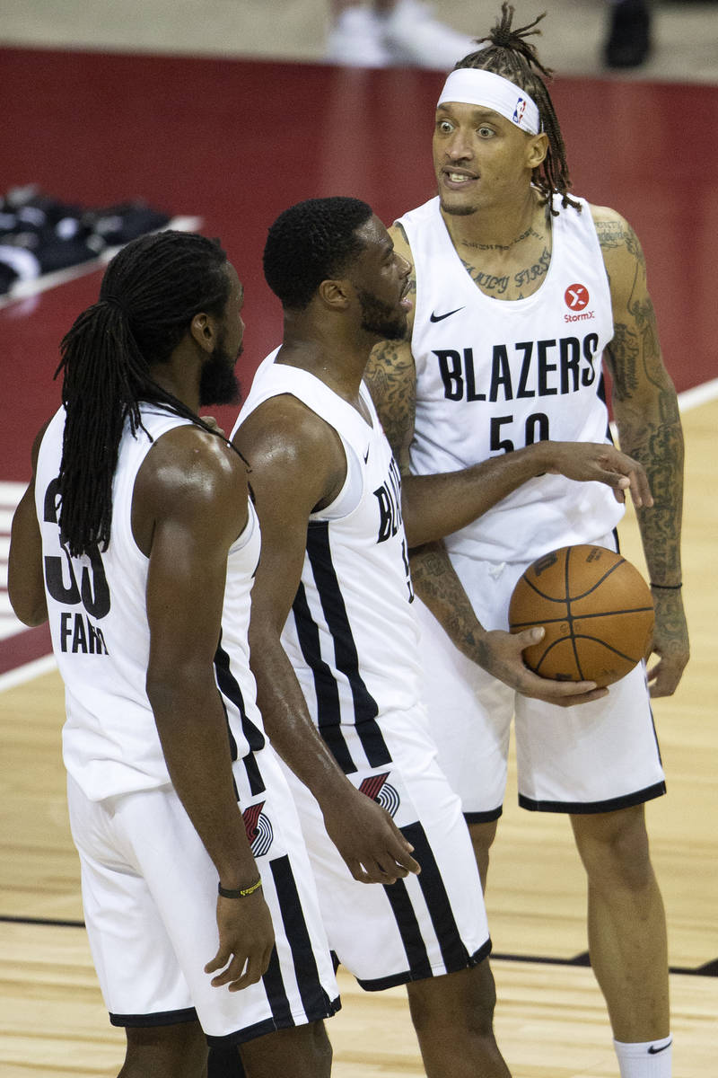 Portland Trail Blazers forward Michael Beasley (50) reacts to a referee's call next to his team ...
