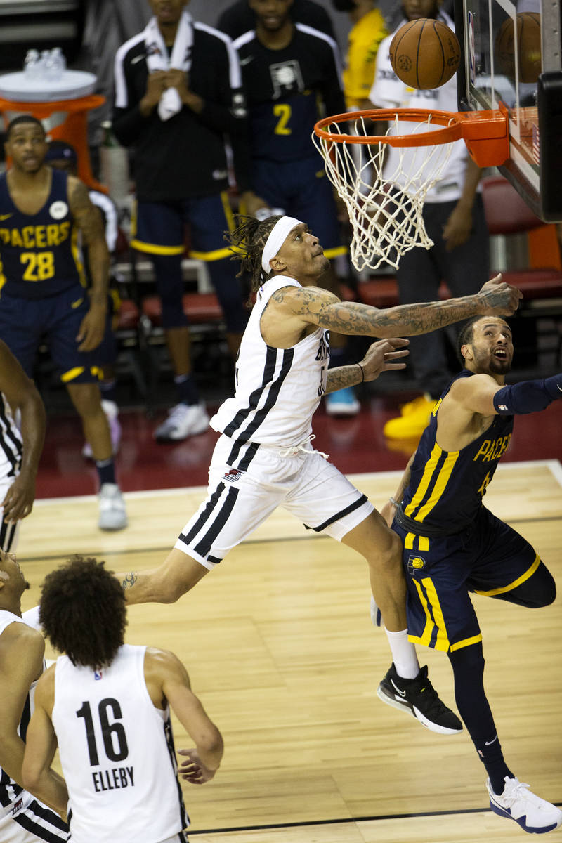 Portland Trail Blazers forward Michael Beasley (50) jumps for a layup next to Indiana Pacers gu ...