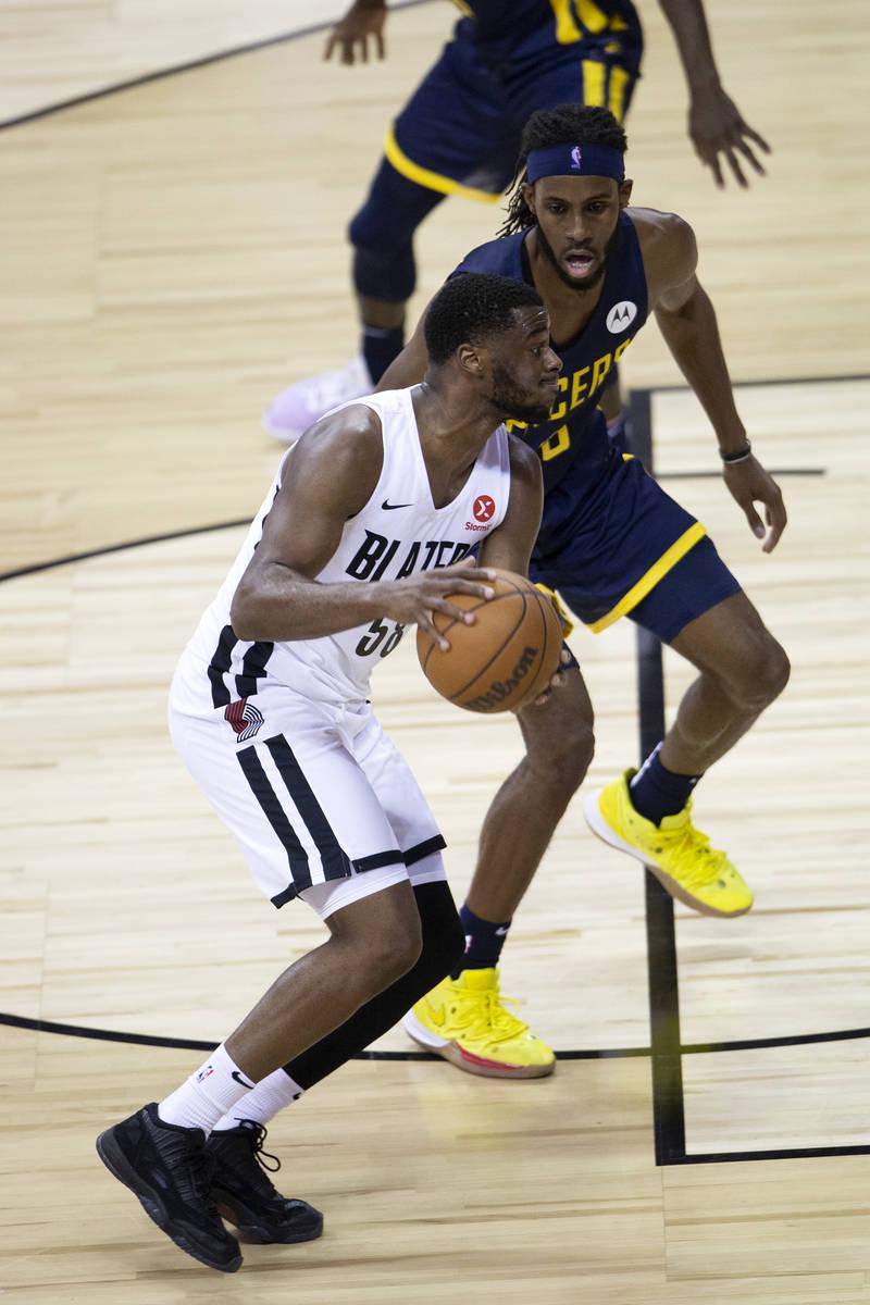 Portland Trail Blazers guard Emmanuel Mudiay (58) dribbles around Indiana Pacers forward Isaiah ...