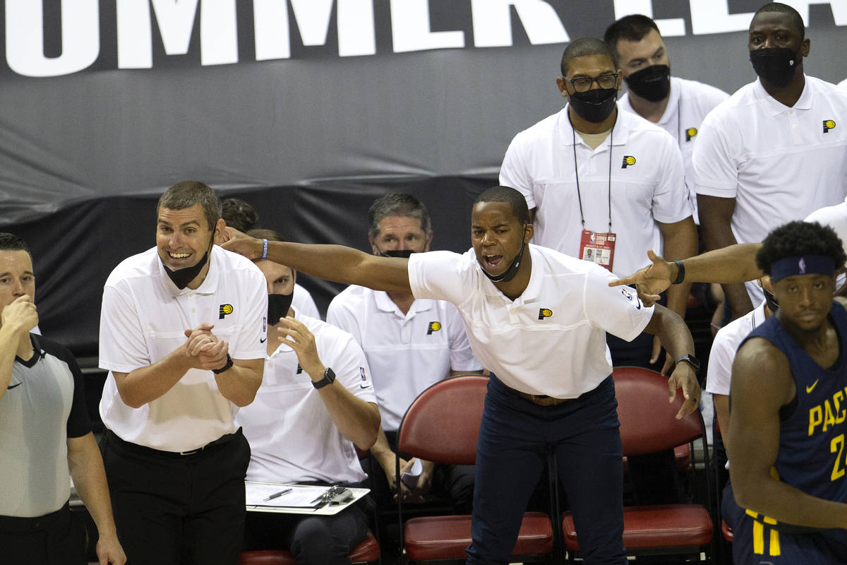 Members of the Indiana Pacers coaching staff, including head coach Mike Weinar, left, express a ...