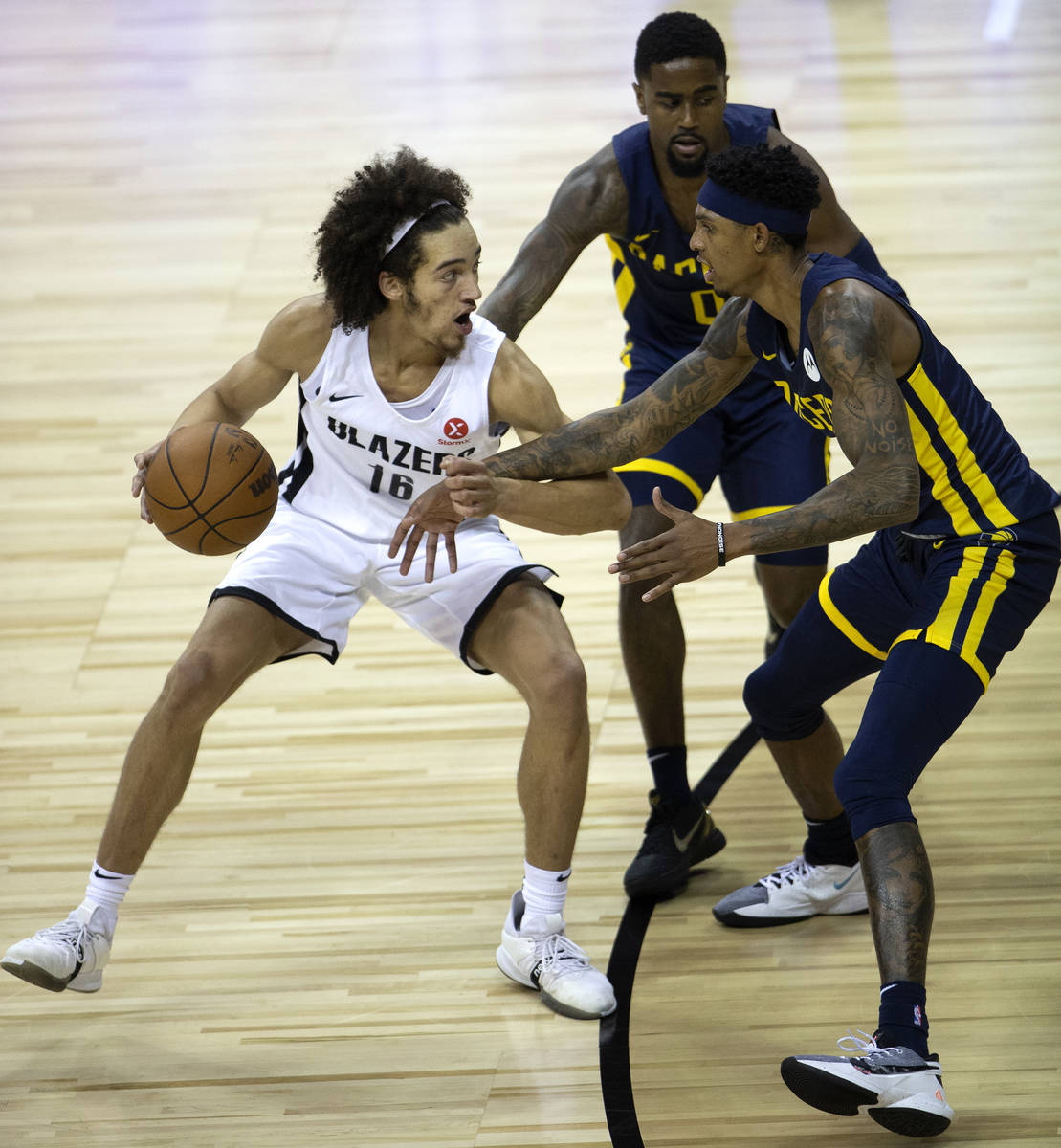 Portland Trail Blazers guard CJ Elleby (16) is guarded by Indiana Pacers forward Devin Robinson ...