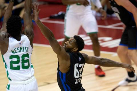 Orlando Magic forward Shakur Juiston (63) attempts to knock down a shot by Boston Celtics forwa ...