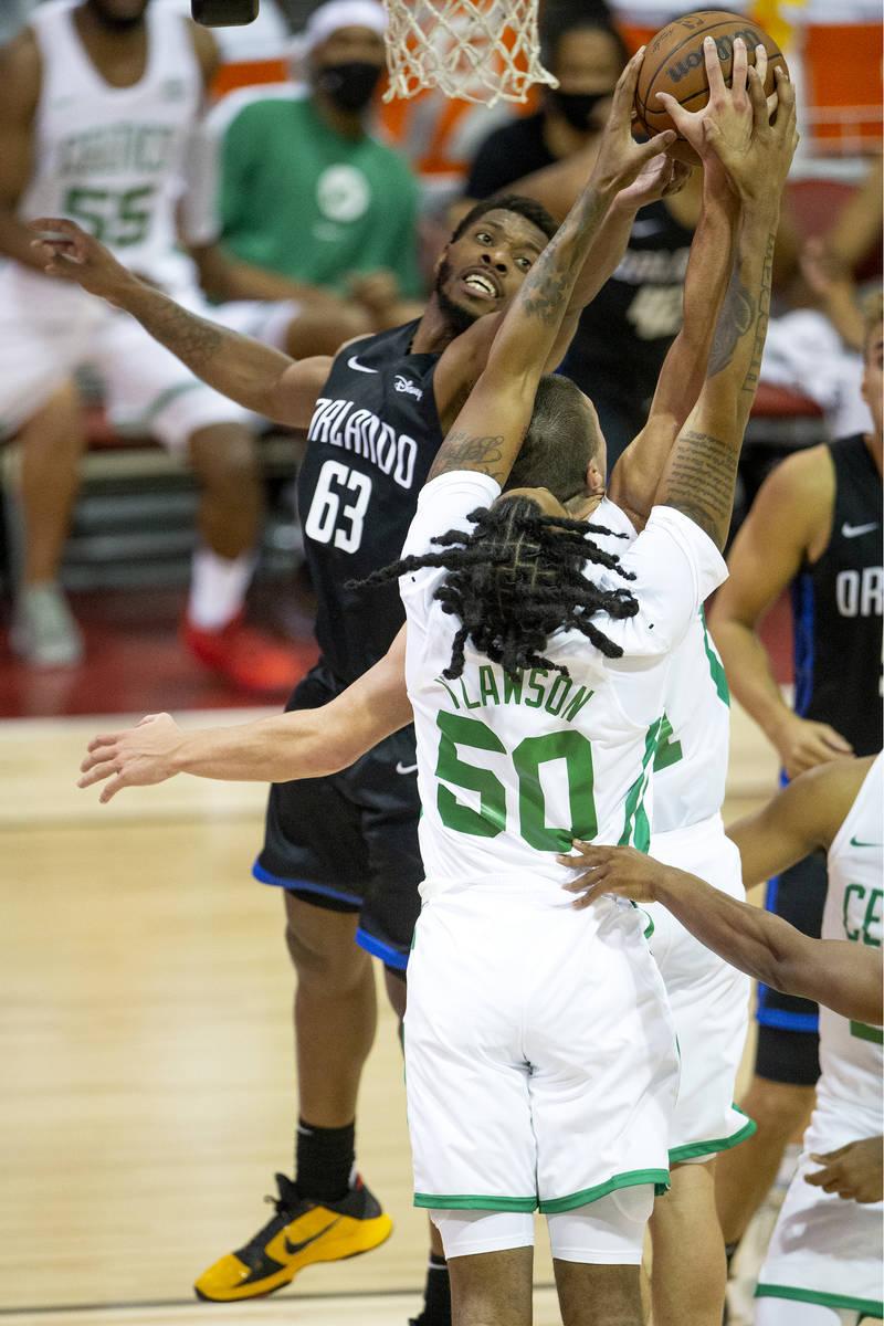 Orlando Magic forward Shakur Juiston (62) knocks down a shot by Boston Celtics guard Payton Pri ...