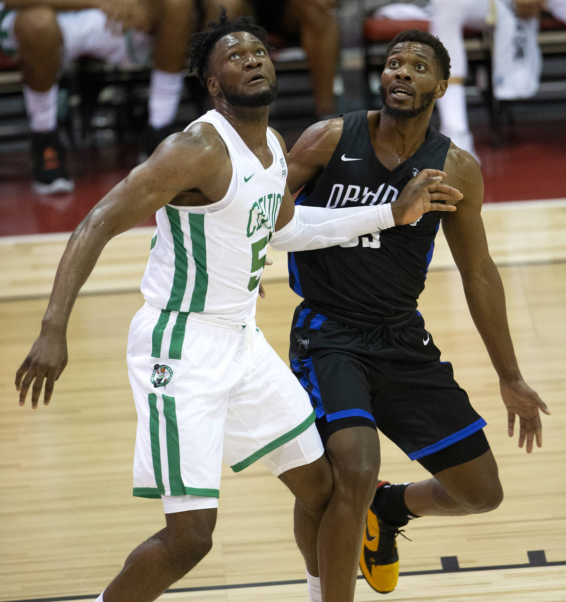 Orlando Magic forward Shakur Juiston (62) guards Boston Celtics forward Bruno Fernando (55) dur ...