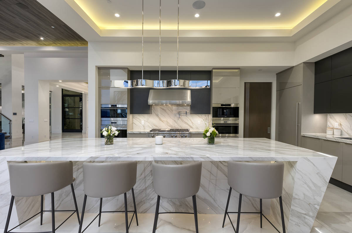 The kitchen features an island with seating. (Kristen Routh-Silberman)