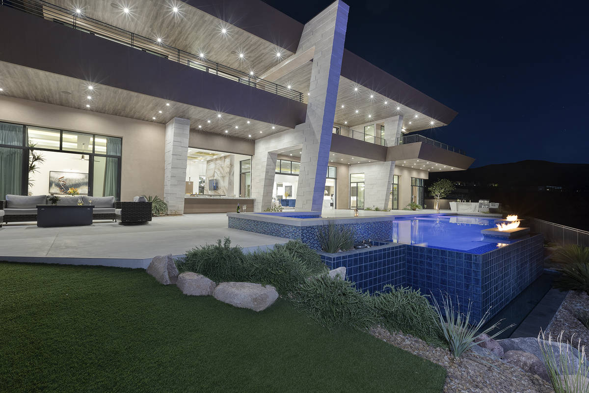The two-story Ascaya home measures 10,030 square feet with seven bedrooms and five baths. (Kris ...