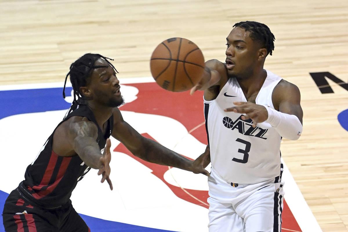 Utah Jazz guard Trent Forrest (3) passes the ball away from Miami Heat guard Marcus Garrett dur ...