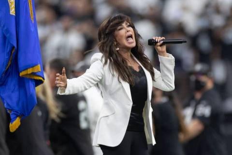 Marie Osmond performs the national anthem before the start of an NFL preseason football game be ...