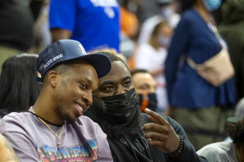 Agent and former UNLV basketball player Jordan Cornish, right, watches a NBA Summer League game ...