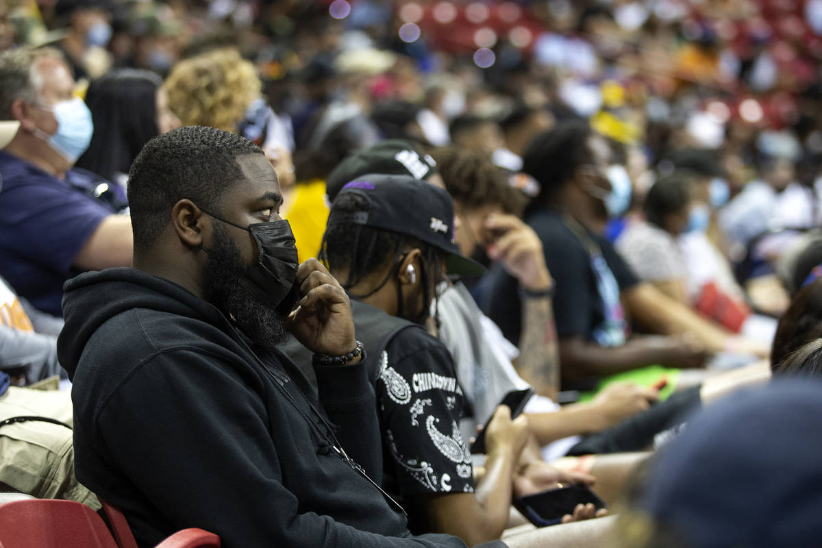Agent and former UNLV basketball player Jordan Cornish answers a phone call while attending a N ...