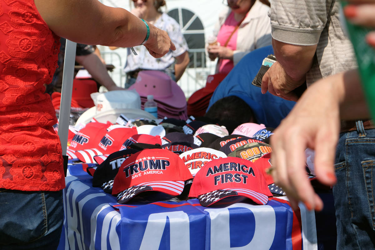 Hats and other items featuring former President Donald Trump on sale at the 6th annual Basque F ...