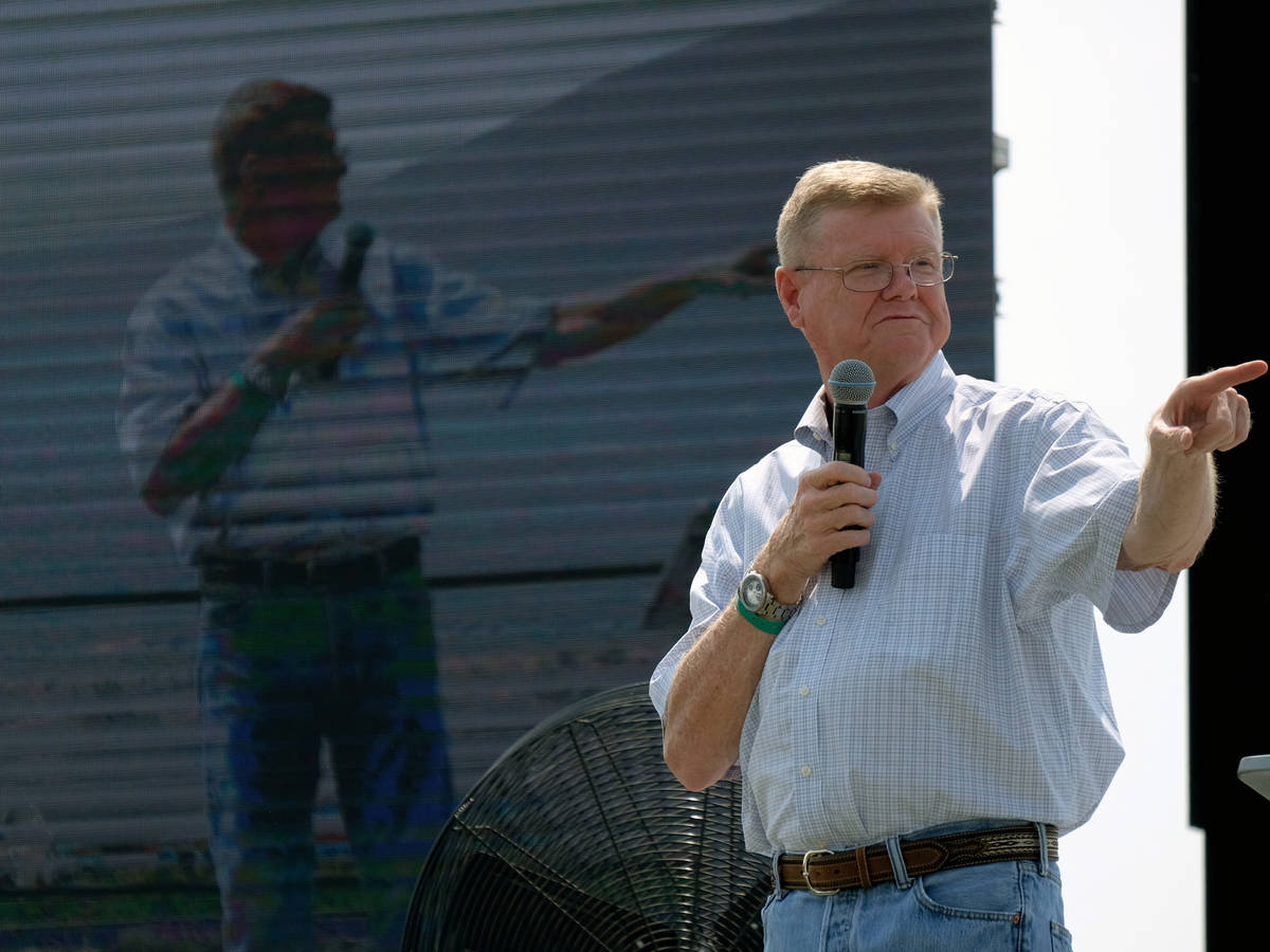 Republican Rep. Mark Amodei appears live and on a big video screen at the 6th annual Basque Fry ...