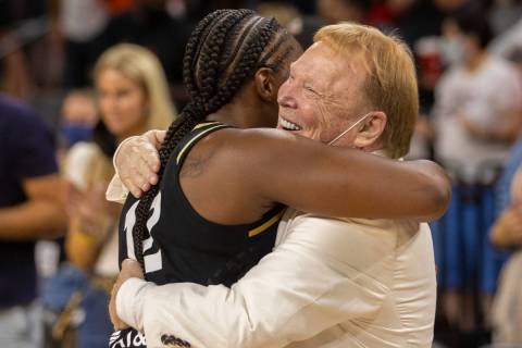 Las Vegas Aces guard Chelsea Gray (12) hugs Raiders owner Mark Davis after Gray hit the winning ...