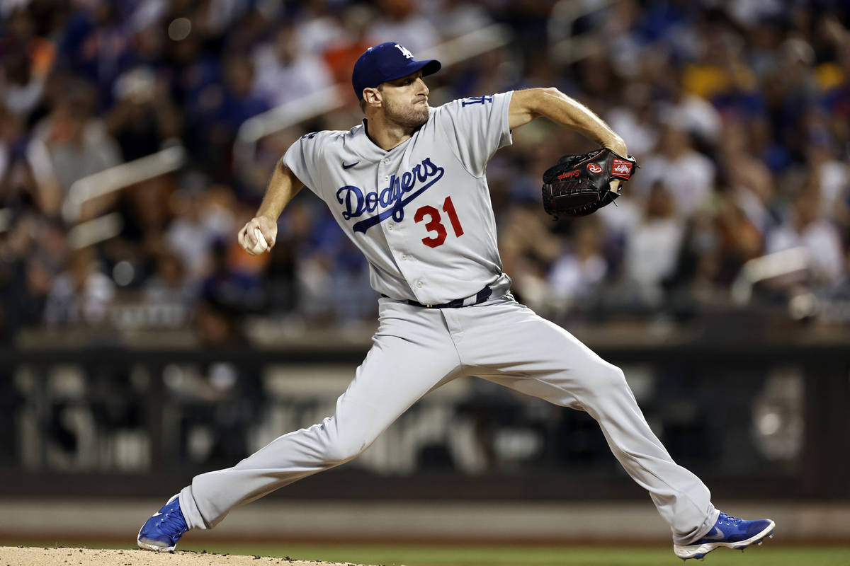 Los Angeles Dodgers pitcher Max Scherzer delivers a pitch during the second inning of a basebal ...