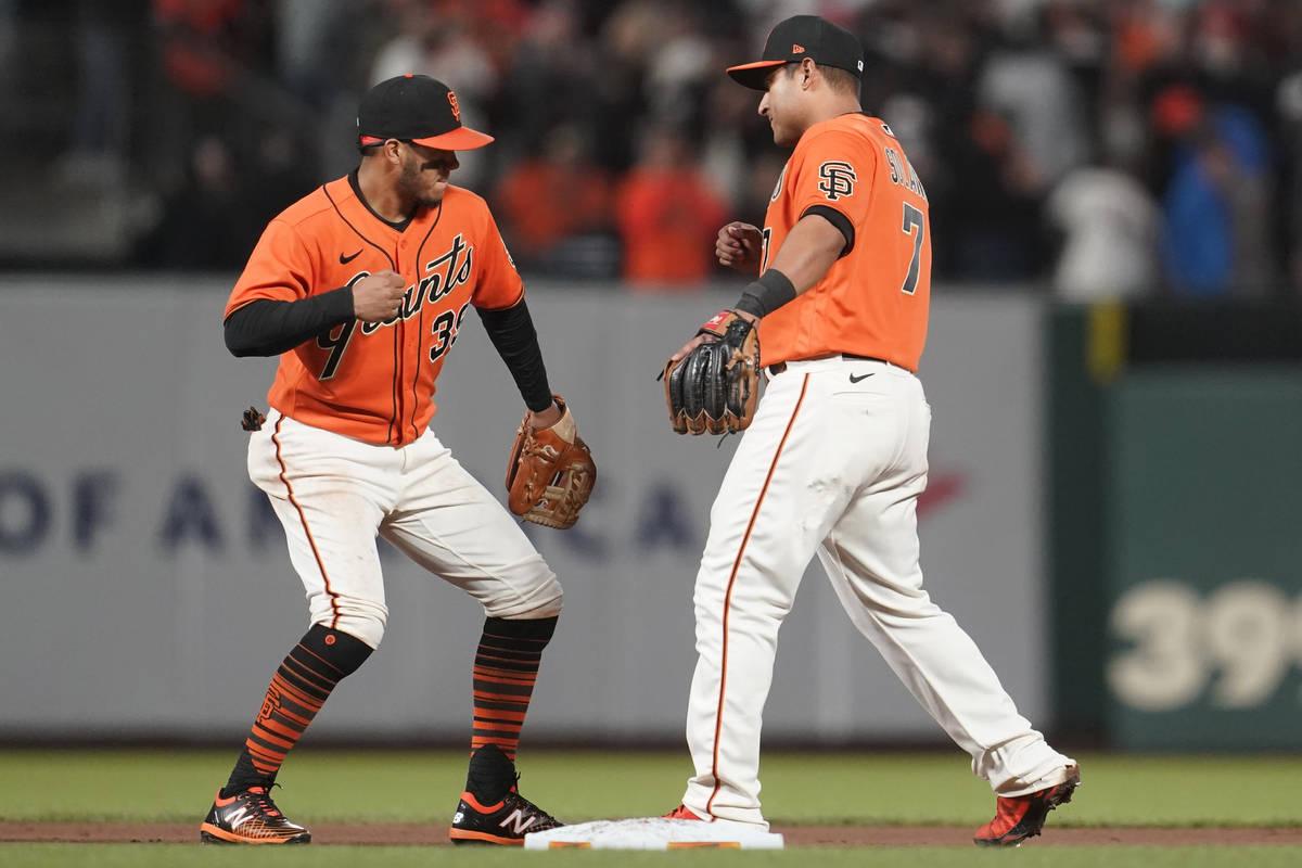 San Francisco Giants' Thairo Estrada, left, and Donovan Solano celebrate after the Giants defea ...