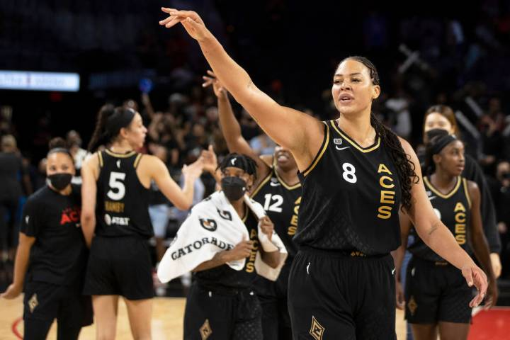 Las Vegas Aces center Liz Cambage (8) waves goodbye to Washington Mystic players after the Ace ...