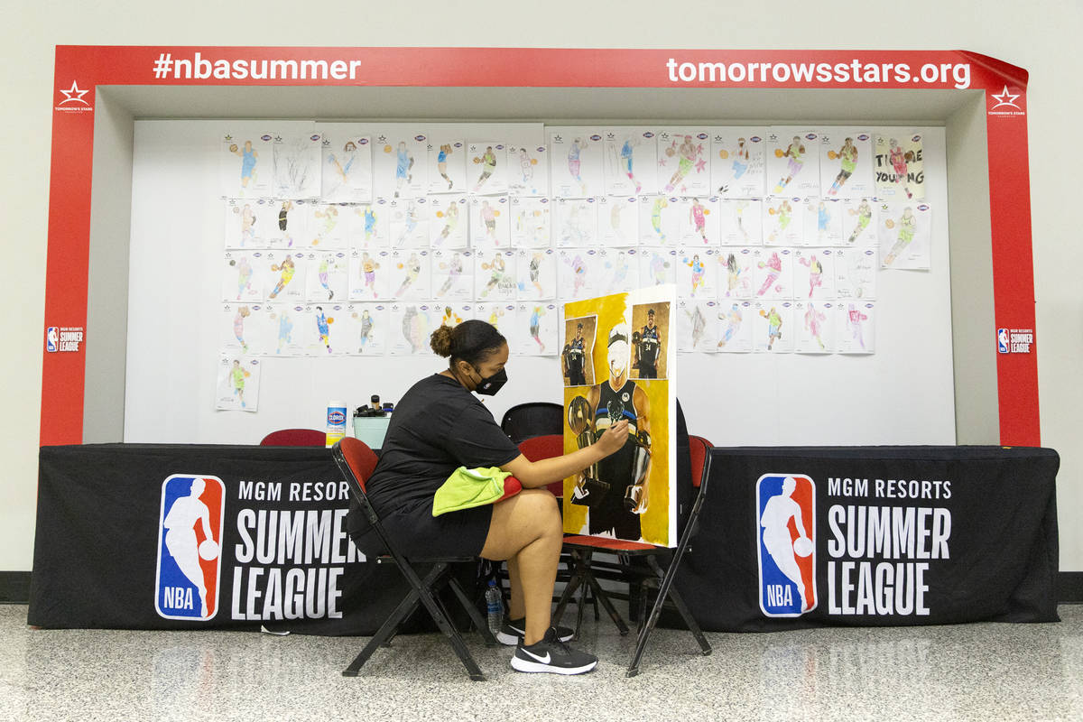 Keely Jackson, a NBA Summer League intern for the third year in a row, does a live painting of ...
