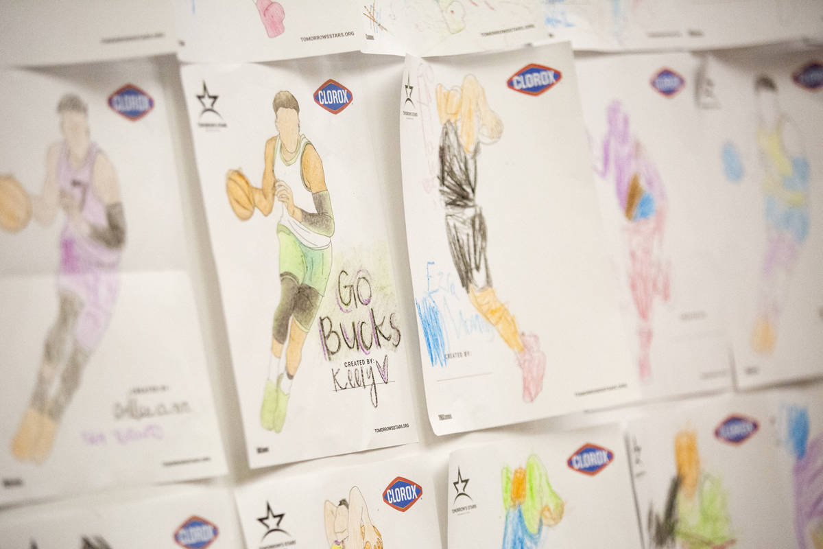A wall of drawings by children adorn the wall on part of the concourse at the Thomas & Mack ...