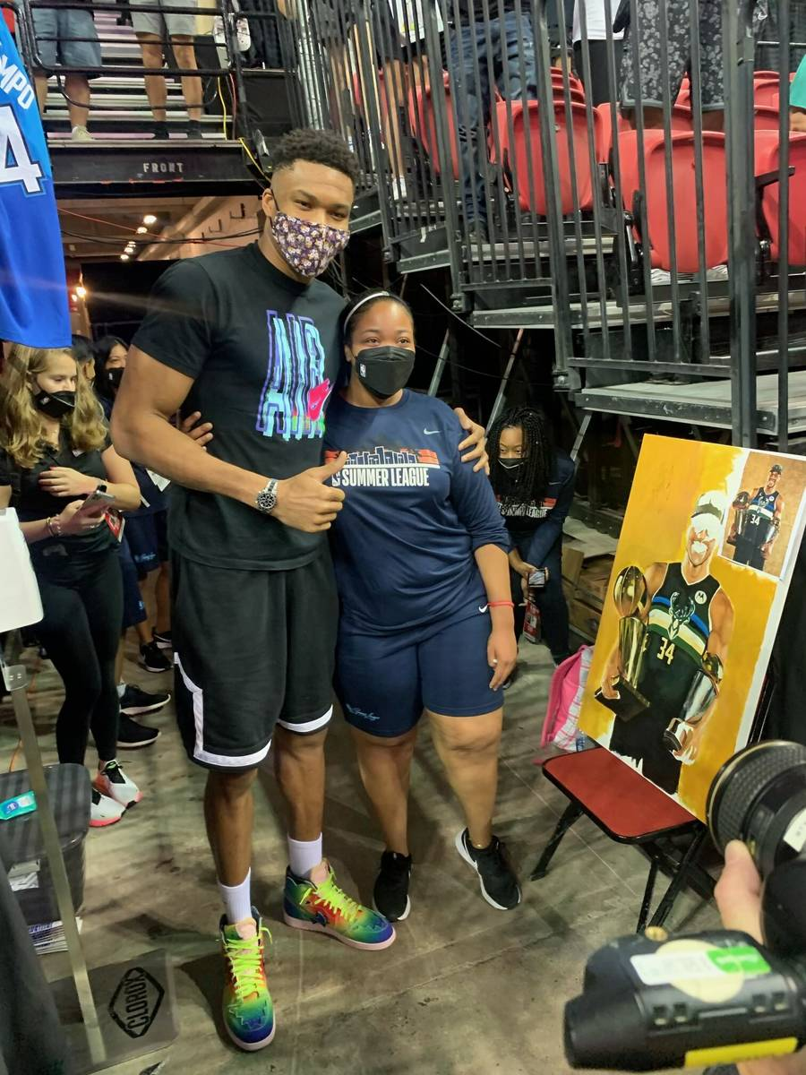 Keely Jackson poses for a photo with Milwaukee Bucks forward and reigning NBA Finals MVP Gianni ...