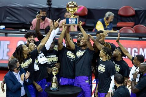The Sacramento Kings hold up their winning trophy after beating the Boston Celtics in a NBA Sum ...