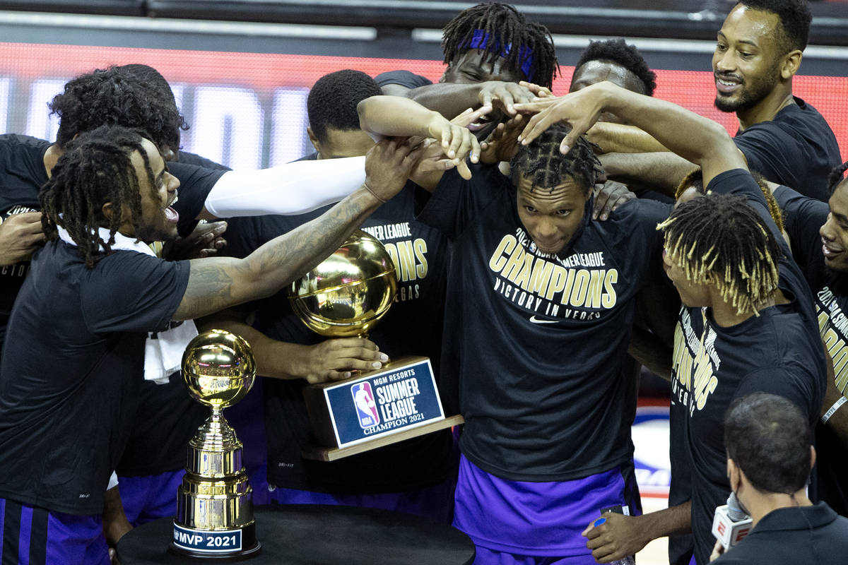 Sacramento Kings forward Louis King, center, is congratulated by his teammates after it is anno ...