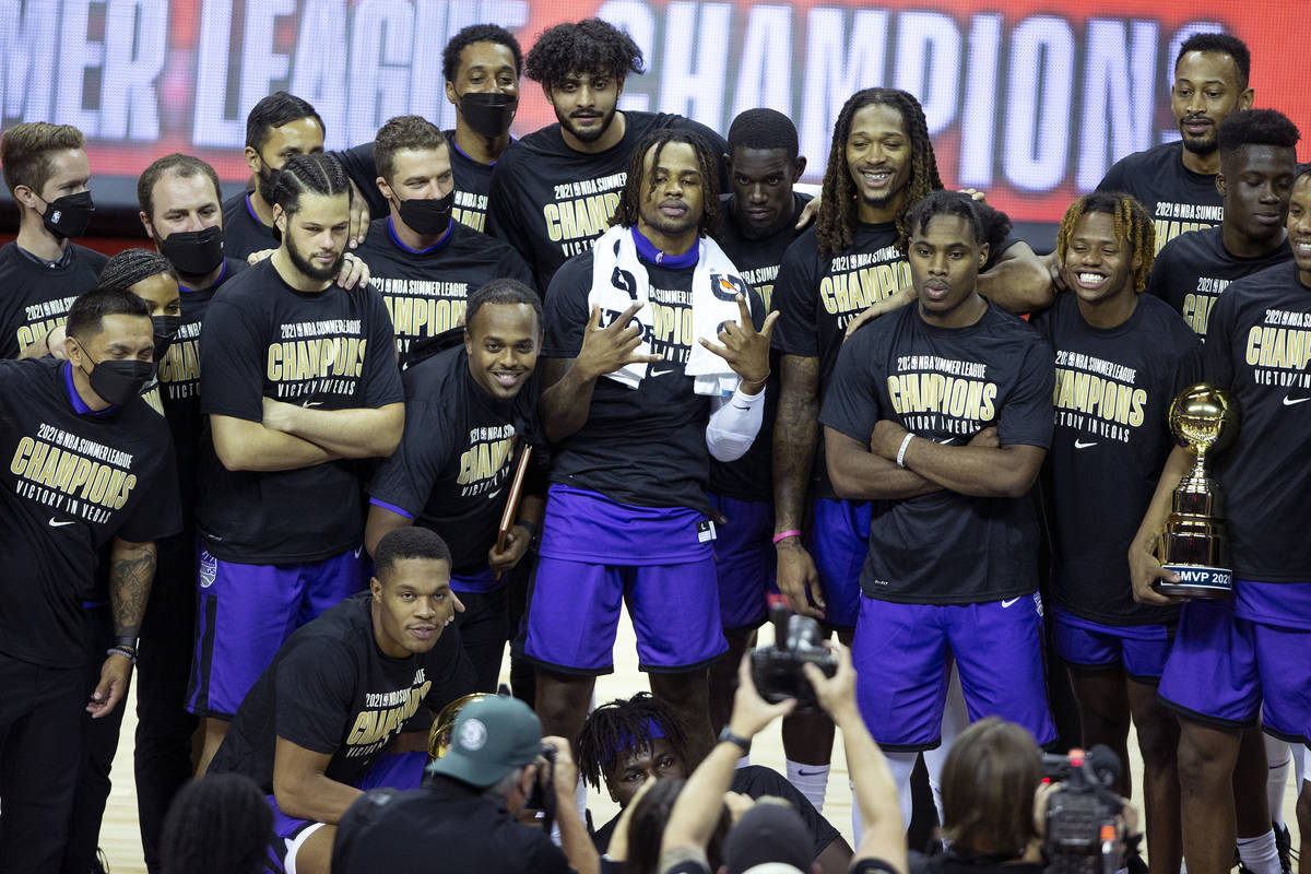 The Sacramento Kings pose for photos after beating the Boston Celtics in a NBA Summer League ch ...