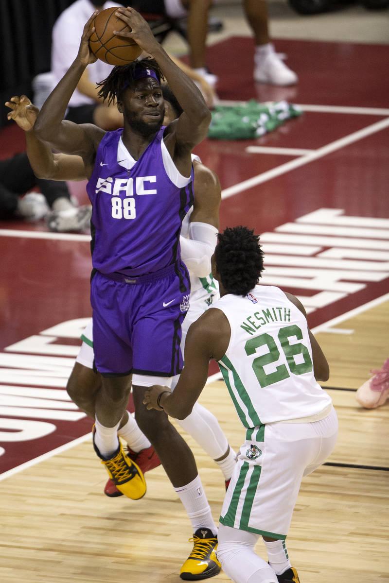 Sacramento Kings center Neemias Queta (88) looks to pass while guarded by Boston Celtics forwar ...