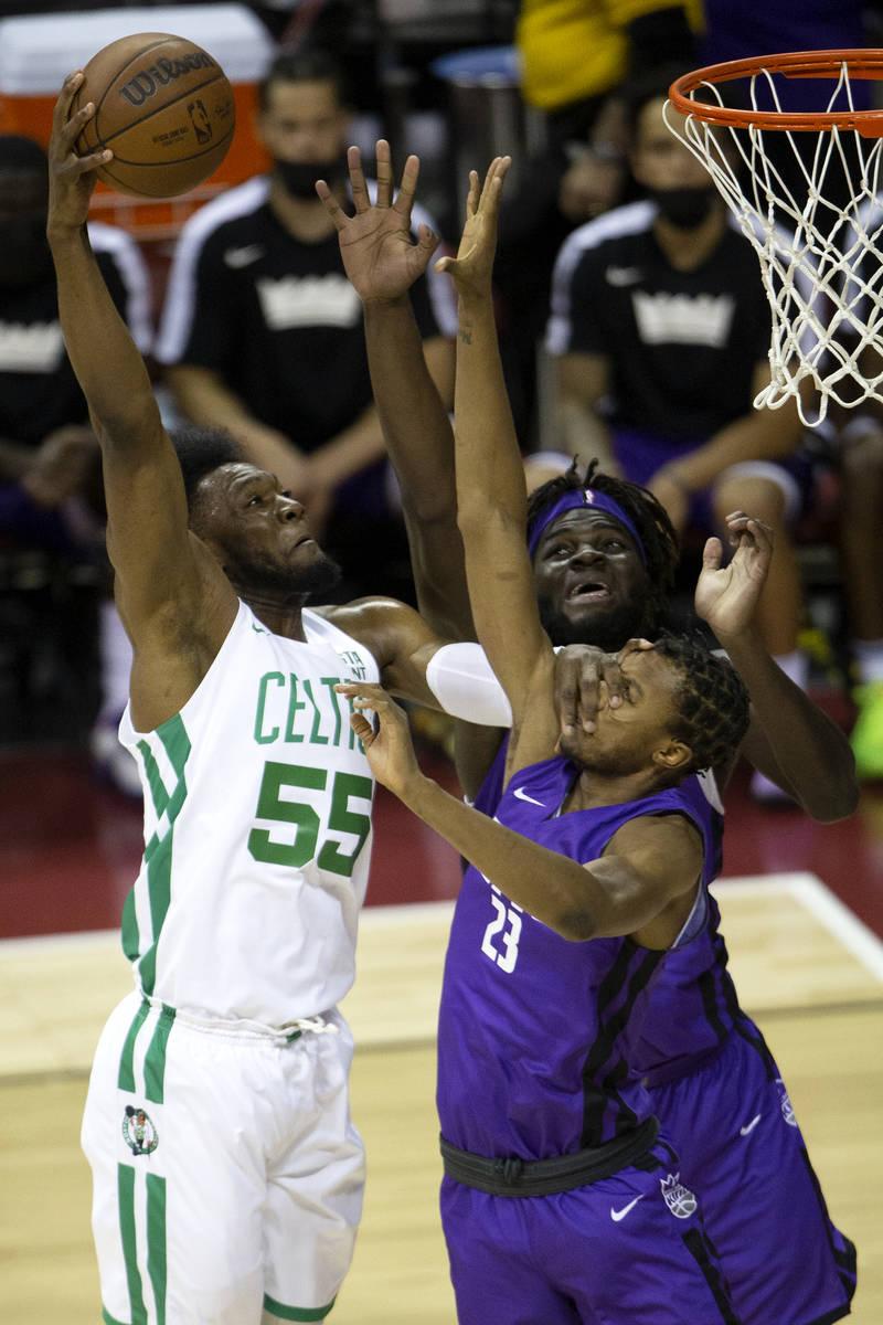 Boston Celtics center Bruno Fernando (55) attempts to score while Sacramento Kings forward Loui ...