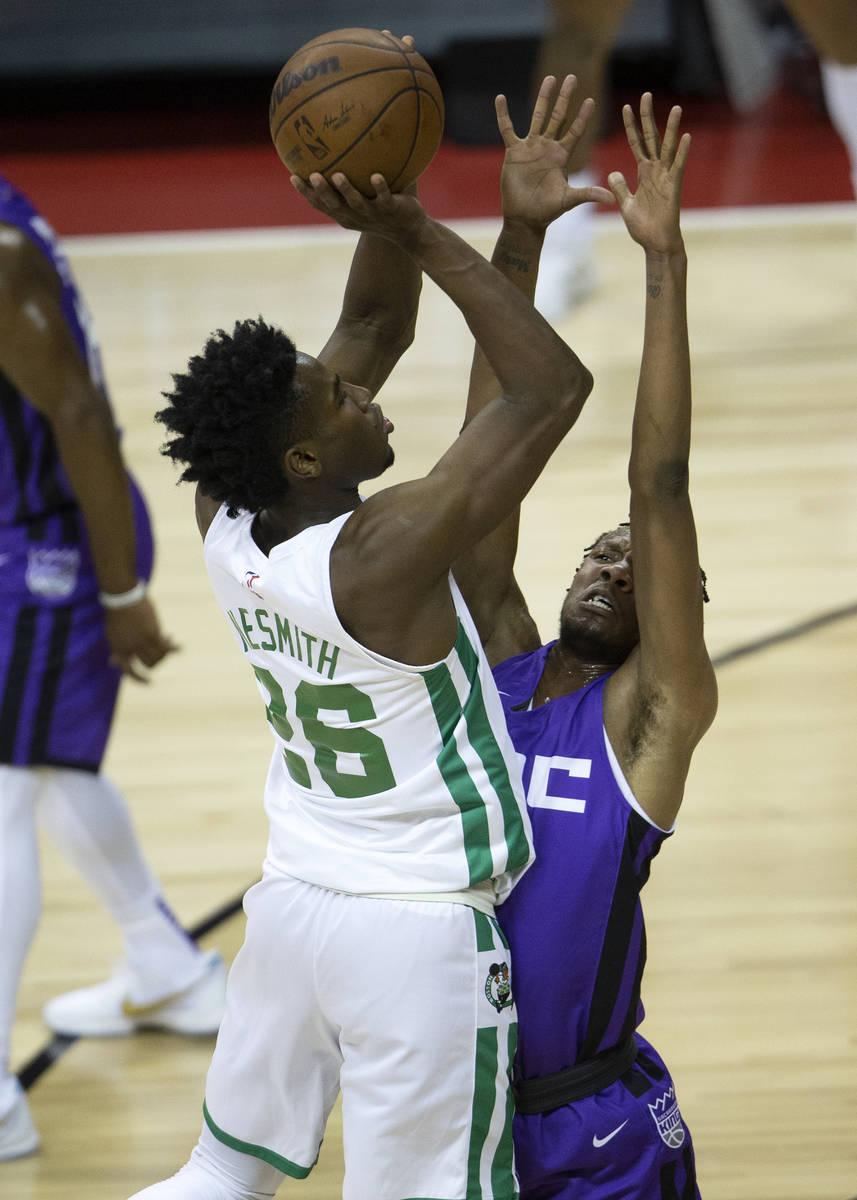 Boston Celtics forward Aaron Nesmith (26) attempts a three-point shot while Sacramento Kings fo ...
