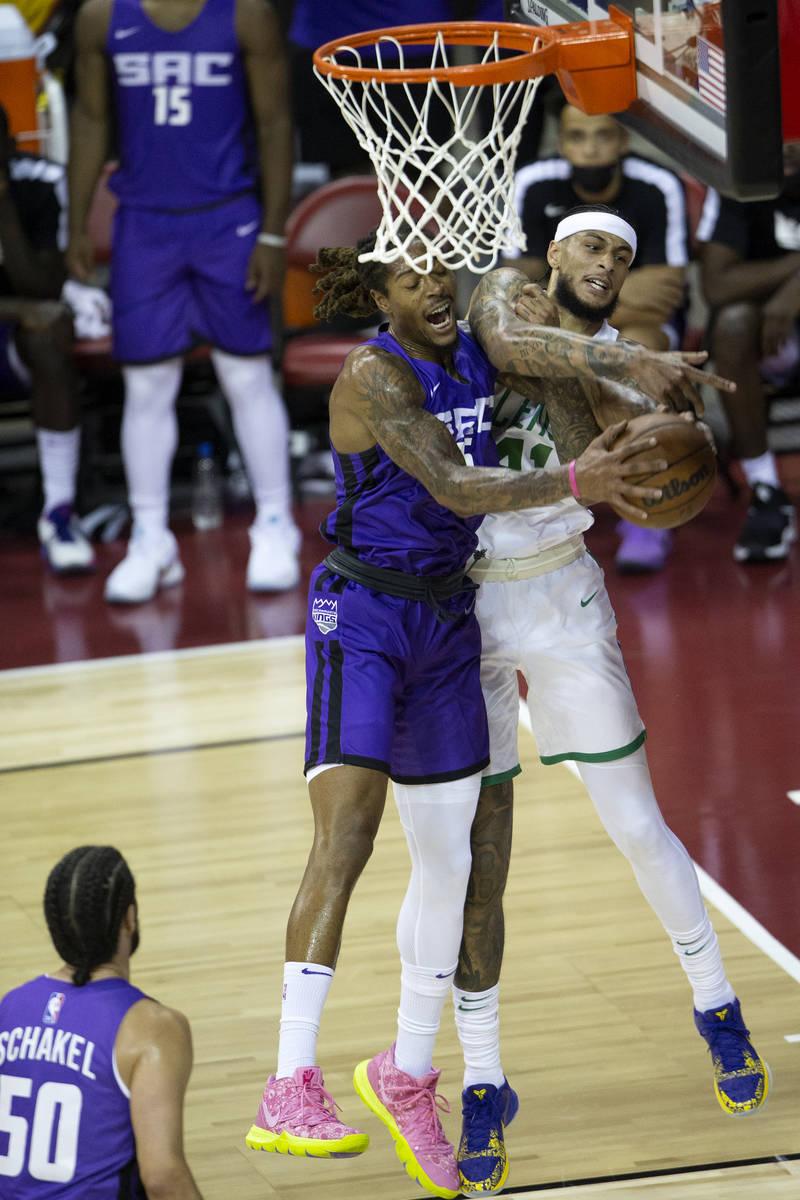 Sacramento Kings forward Emanuel Terry (26) knocks down a shot by Boston Celtics center Zach Au ...