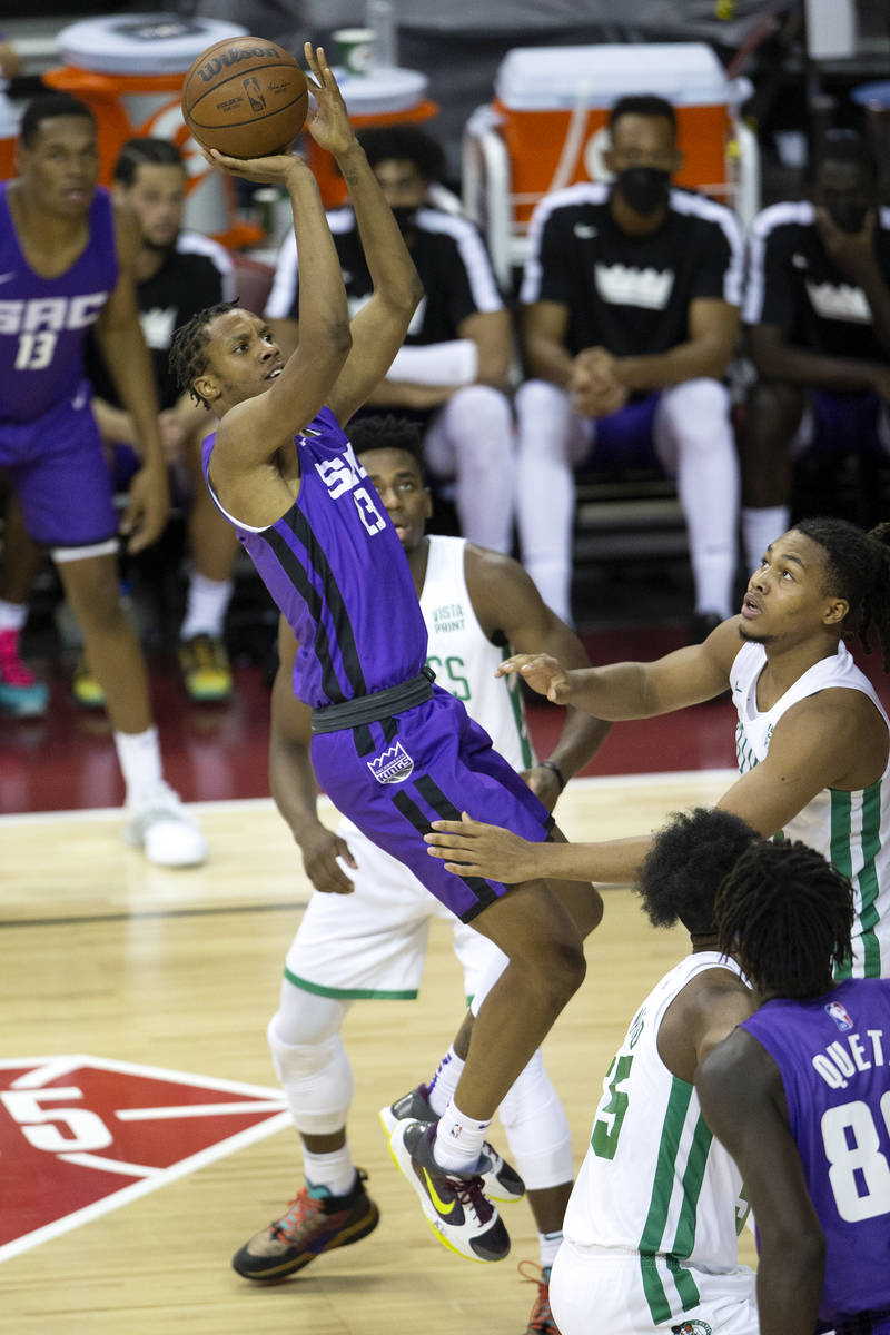 Sacramento Kings forward Louis King (23) shoots a three pointer guarded by Boston Celtics guard ...