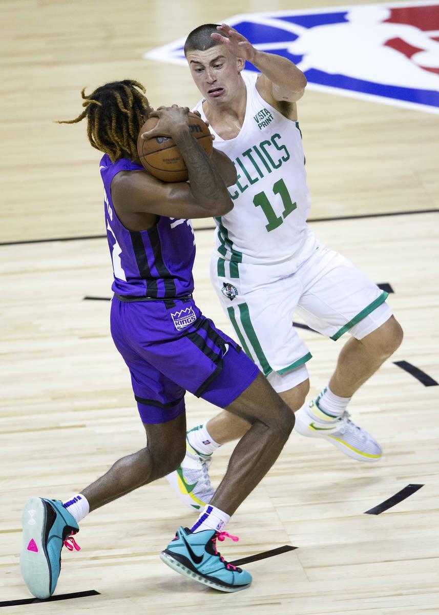 Boston Celtics guard Payton Pritchard (11) guards Sacramento Kings guard DJ Steward (32) during ...