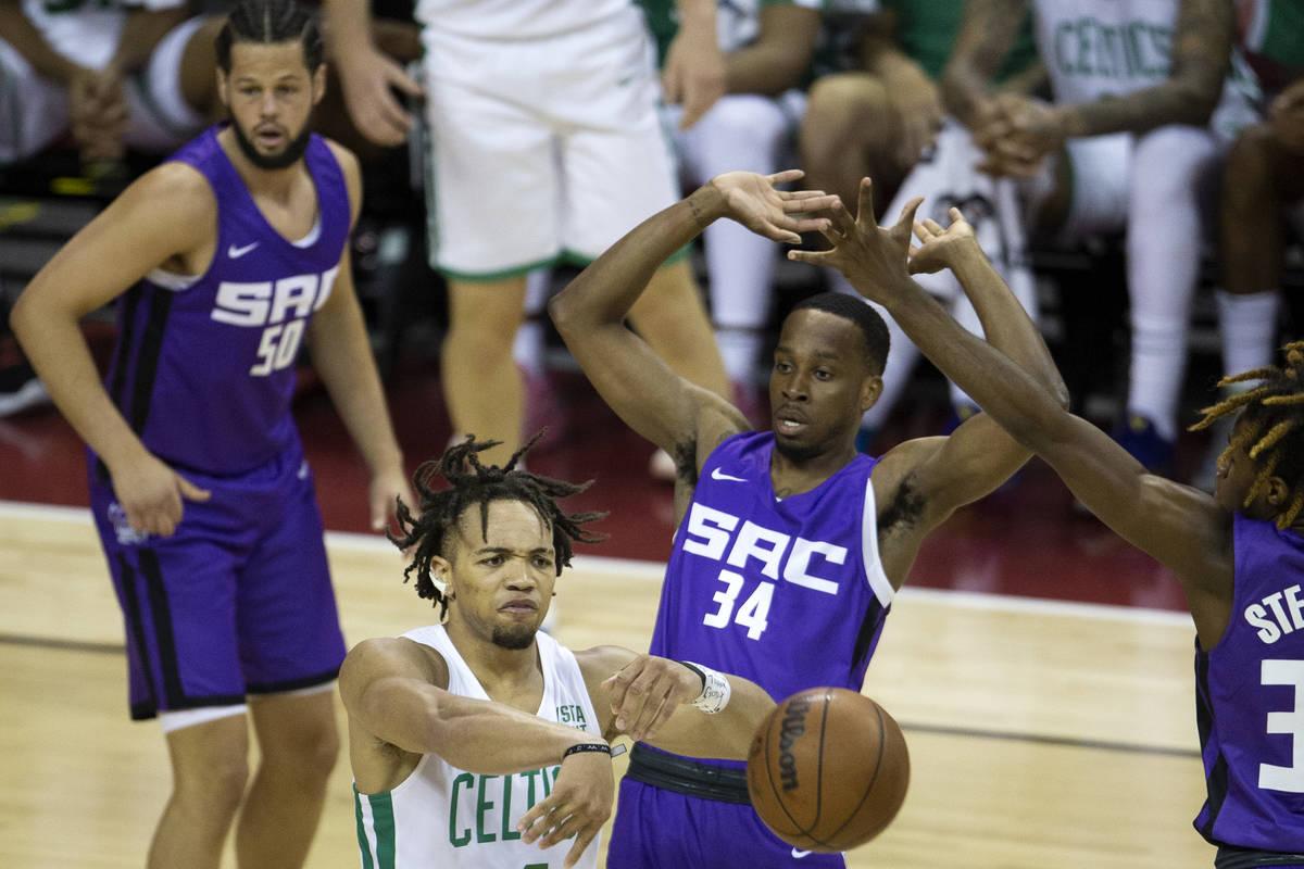 Boston Celtics guard Carsen Edwards (4) passes while Sacramento Kings guard DJ Steward, right, ...