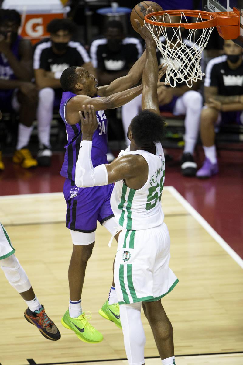 Sacramento Kings guard Matt Coleman III (34) goes for a layup while Boston Celtics forward Brun ...