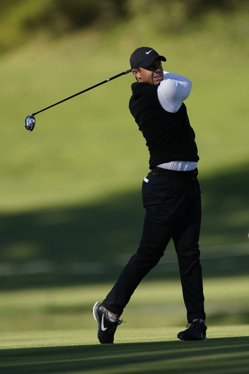 Rory McIlroy, of Northern Ireland, hits his second shot on the 17th hole during the second roun ...