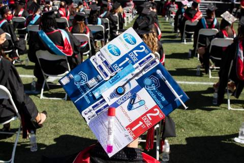 Talih Kadi decorates his graduation cap with COVID-19 and Pfizer themes during the first of sev ...